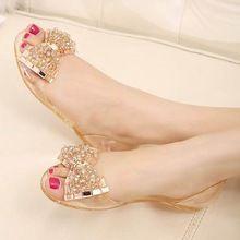 Mulheres sandálias de verão confortáveis sandálias da geléia de cristal arco senhora apartamentos sapatos sapatos baixos com strass de plástico transparente(China (Mainland))