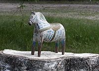 Dala horse painted by Rytter Olof Matsson, around 1910. Description from pinterest.com. I searched for this on bing.com/images