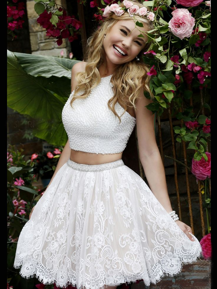 Dance and have fun in this Sherri Hill prom dress. This two piece Sherri Hill cocktail dress 32313 has a high neckline, gorgeous fitted bodice embellished with pearls, and a short lace skirt. Features:  Silhouette: Short  Neckline: High Neckline  Available in sizes 00 through 14   Colors include ivory