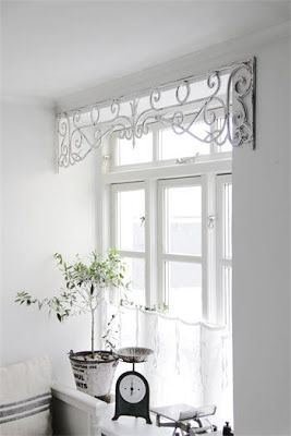 Love the salvaged metal window frieze used as a valance.