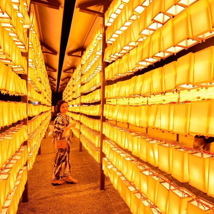 Rows of lanterns are lit during the Mitama Matsuri festival at the Yasukuni Shrine in Tokyo, Japan. About 30,000 lanterns were illuminated in the precinct in memory of the war victims. (📷: TORU YAMANAKA/AFP/Getty Images)