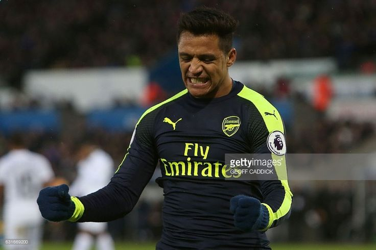 Arsenals Chilean striker Alexis Sanchez celebrates scoring his teams fourth goal during the English Premier League football match between Swansea City and Arsenal at The Liberty Stadium in Swansea, south Wales on January 14, 2017. / AFP / Geoff CADDICK / RESTRICTED TO EDITORIAL USE. No use with unauthorized audio, video, data, fixture lists, club/league logos or live services. Online in-match use limited to 75 images, no video emulation. No use in betting, games or single club/league/p...