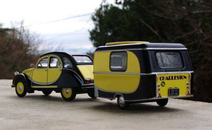 Citroen 2CV with Eriba camper in matching black and yellow.
