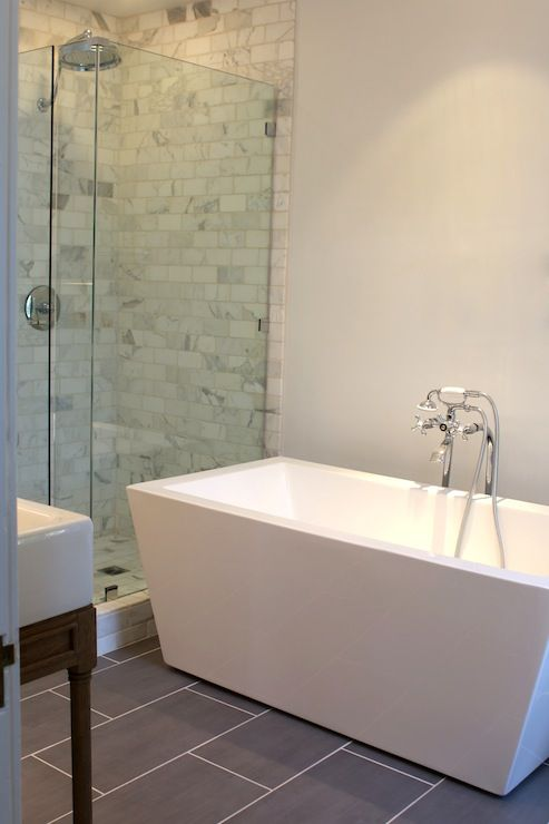 Stunning master bath with glass shower enclosure filled with marble subway tile shower ...