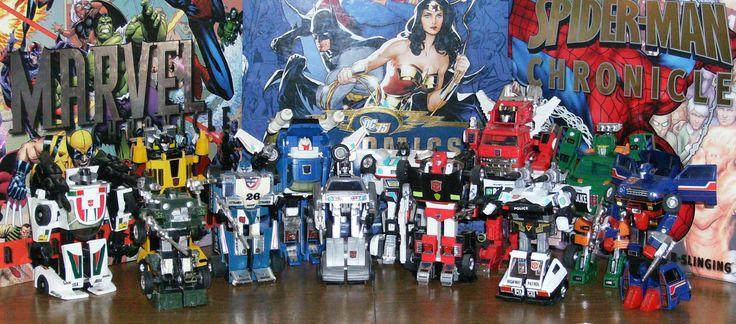 Autobots--roll out! L to R: Wheeljack, Sunstreaker, Hound, Mirage, Tracks, Camshaft, Jazz, Sideswipe, Inferno, Prowl, Hoist, Skids.
