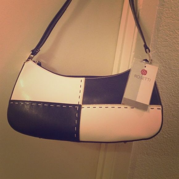 Nice black and white purse for sale Great condition it's a small purse Rosetti Bags