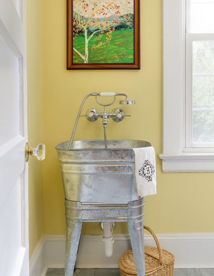 Galvanized tub sink laundry room transitional with white door metal utility sink