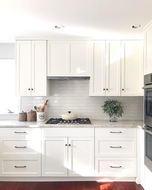 Trim Design Co Classic White Kitchen Features Custom Cabinetry