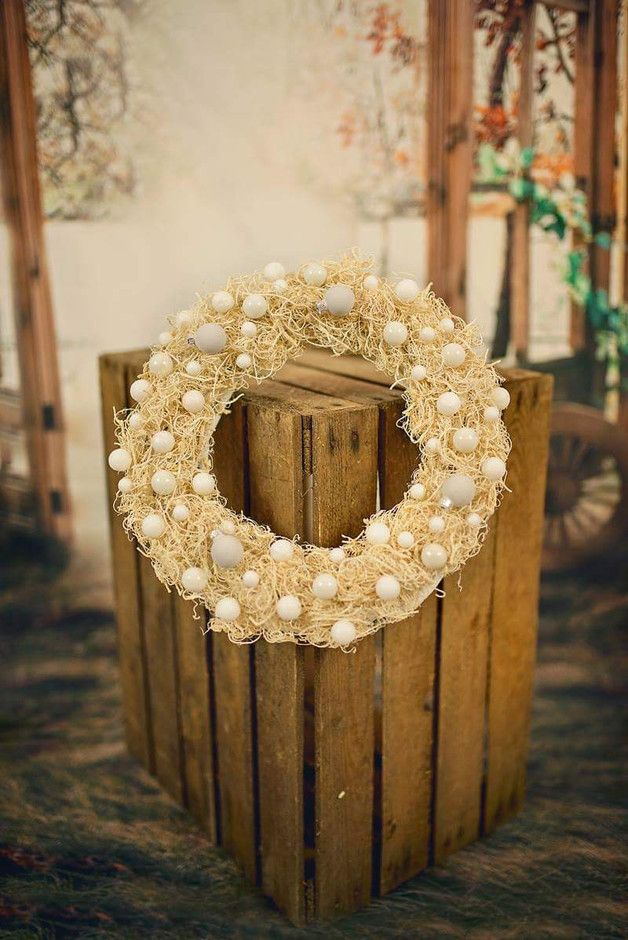 The original Christmas wreath. Wreath decorated with baubles and white brocade balls sparkling like snow and Sianki ecru. Universal colors make that will fit into any interior and will be a...
