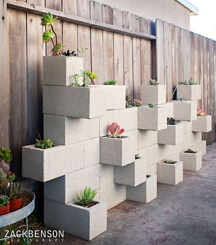 Build a unique planter from cinder blocks. Architectural photographer Zack Benson came up with the innovative idea of using stacked and glued cinder blocks to create a cheap and easy DIY succulent planter.
