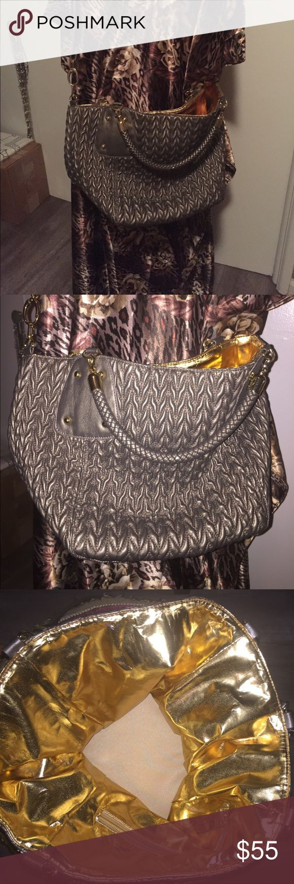Big Buddha Bag! NWOT New without tags! Never used ! This Big Buddha bag is gorgeous! Great for travel! Textured gray exterior- Gold interior. Handles or shoulder strap for cross body! Perfect condition. Big Buddha Bags Totes