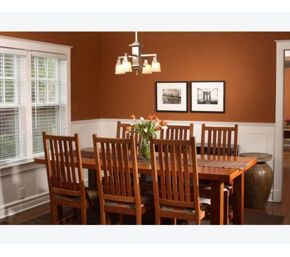 Warm And Inviting Dining Room Featuring Mission Style Furniture