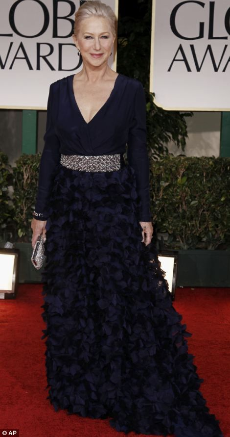 The fabulous 66-year-old Helen Mirren made all the young starlets look hopelessly gauche. This navy dress with cardigan top and ruffled skirt by American design duo Badgley Mischka, one of her favourite labels, worked because it followed Mirren's golden rules: 1. It gives her a nipped-in waist. 2. It covers her arms.3. It shows