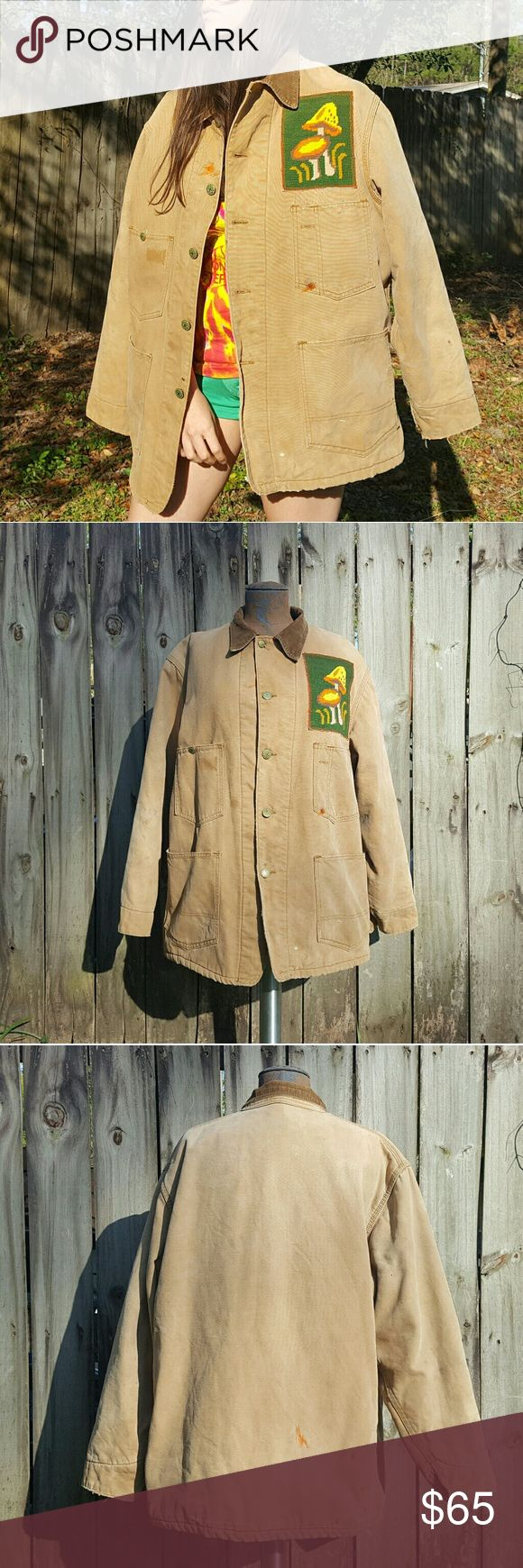 """Distressed mushroom jacket A beat up vintage Oshkosh jacket has been given new life with a vintage mushroom needlepoint patch. Lots of wear and tear and overall distressing gives this piece a unique hippie flair. Made from lined canvas. One of a kind, not a """"perfect"""" piece but you'll look flawless! Fits MANY unisex sizes up to mens XL. Better than Urban Renewal, the purchase of this piece goes to a home seamstress, not a corporation. Shiloh Lives Jackets & Coats Military & Field"""