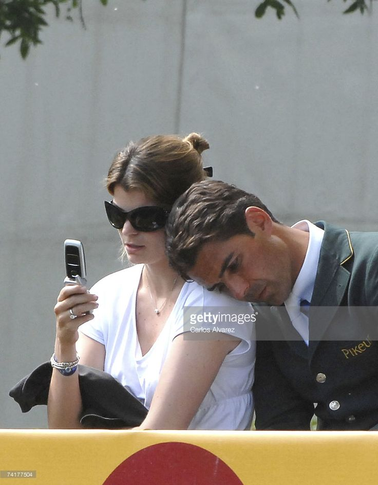 French-Greek Athina Onassis sits with her Brazilian husband, Alvaro Alfonso de Miranda Neto, known as Doda Miranda, who is competing in the 97th International Showjumping Tournament at the Club de Campo Villa de Madrid on May 17, 2007 in Spain.
