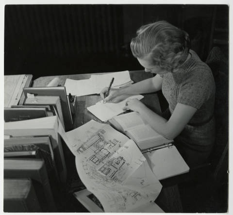 Archaeology student writing at a desk :: Archives & Special Collections Digital Images :: circa 1937-1938