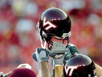 Google Image Result for http://www.amesphotos.com/virginia_tech_photos/images/Virginia-Tech-Football-Action-Hands-on-Helmet-VT-F-OAC-00032lg.jpg