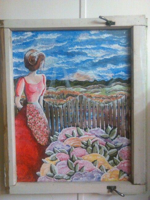 Painting in wooden window frame