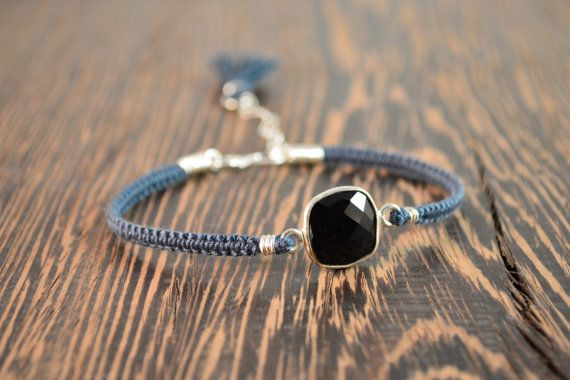 The focal point of this upscale macrame bracelet is the onyx set in a bezel at it's center.  This beautiful jet black stone set in a sterling silver bezel, is completely opaque and has been faceted to reflect light. The straps are hand knotted with soft and luxurious 100% silk thread in a deep denim blue that compliments the stone.  All of the findings are made from sterling silver.       And at the back an easy to use hand formed hook clasp with an extender chain.  The hook and extender…