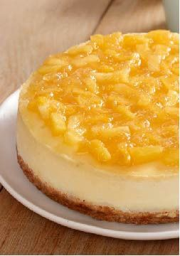 Pineapple-Topped New York Cheesecake – Start spreading the news—New York cheesecake has made a brand-new start of it with a sweet and tangy pineapple topping.