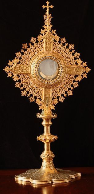 To a devout and pious Roman Catholic, this is physically Jesus Christ not in the bread, but rather, Jesus Christ is appearing in this picture with the properties of bread. The Holy Eucharist.