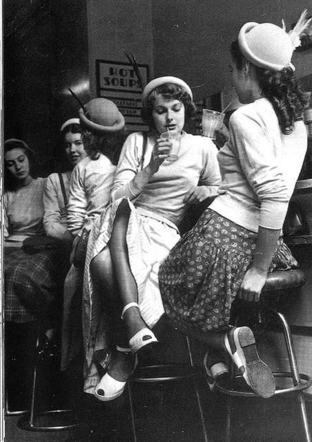 Girls having fun in a milk bar in England, 1954.