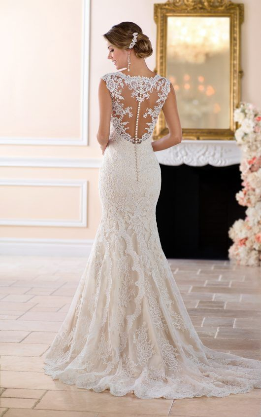 6418 Vintage Lace Trumpet Wedding Dress by Stella York. Find this dress at Janene's Bridal Boutique located in Alameda, Ca. Contact us at (510)217-8076 or email us info@janenesbridal.com for more information.