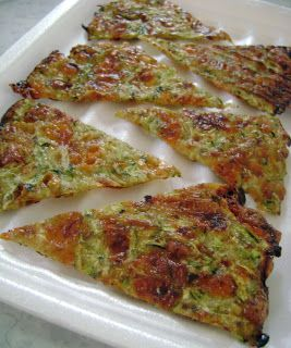 Zucchini Cheese Wedges  These are awesome! I spread mine out over the entire baking sheet. I also added red pepper seeds and bacon pieces.