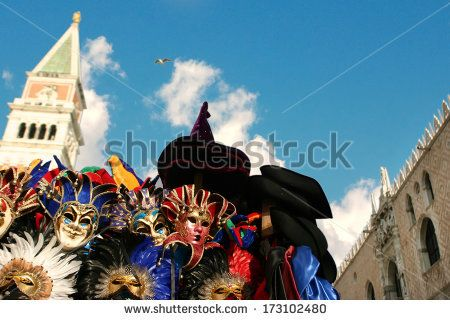 Venice masks against San Marco bell tower - stock photo