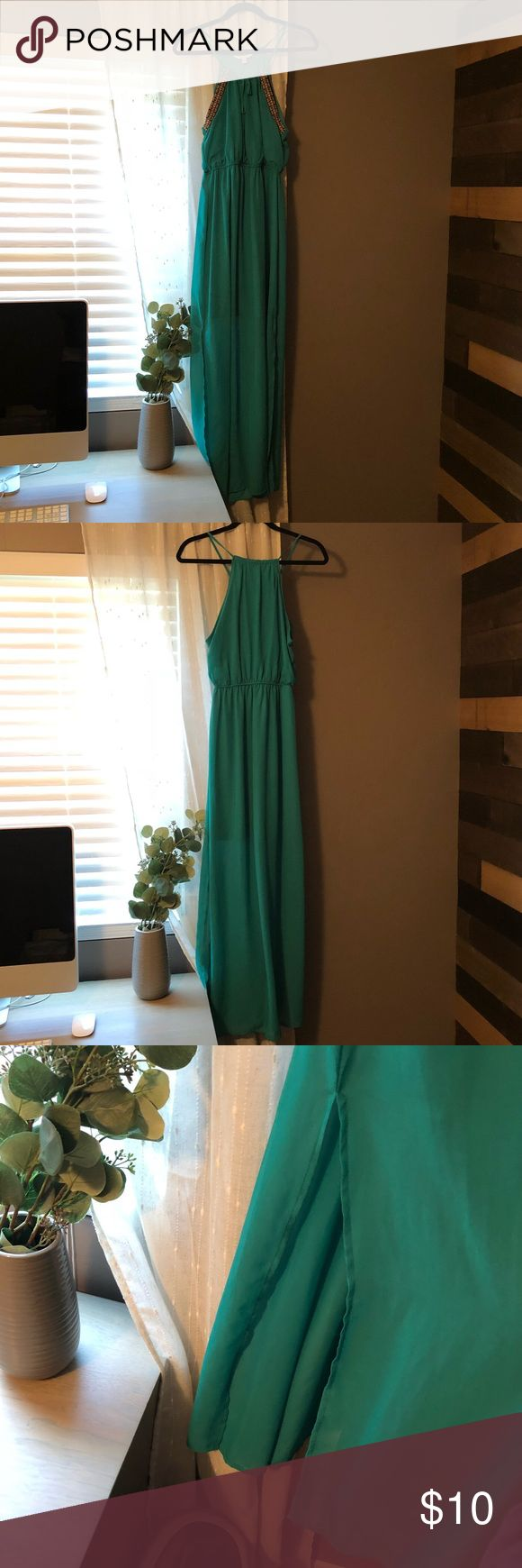 Turquoise maxi dress from Charming Charlie's Turquoise maxi dress from Charming Charlie's... worn once, in good condition... shows tribal accents on front of dress... size medium Charming Charlie Dresses Maxi