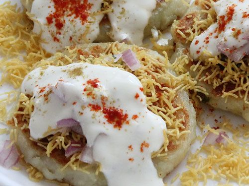 This tongue tickling aloo tikki chaat recipe uses stuffed spicy aloo tikki and other typical chaat ingredients like sev, chopped onions and assortment of chutneys to recreate the best Indian street food experience.