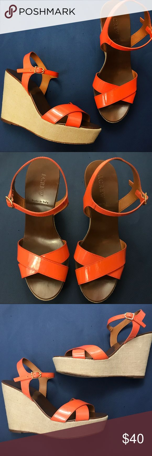 J. Crew Orange Patent Leather Cross Sandal Wedges Super cute orange wedges from J. Crew!  Orange patent leather material on top with a tan brown canvas wedge base.  Dark brown leather sole. Size 8.  Some wear on the bottom sole as shown.  No signs of wear on the orange, inner sole, or sides.  Add your favorite listings to a bundle to receive a special discount! J. Crew Shoes Wedges