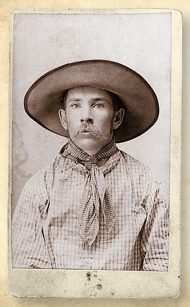 "This cowboy fits the description (at least the top half!) given in an 1871 Kansas newspaper: ""His dress consists of a flannel shirt with a handkerchief encircling his neck, butternut pants and a pair of long boots, in which are always the legs of his pants. His head is covered by a sombrero, which is a Mexican hat with a high crown and a brim of enormous dimensions."""