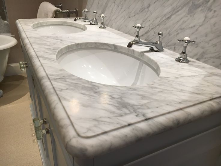 Carrara honed marble double vanity top with New York edge detail
