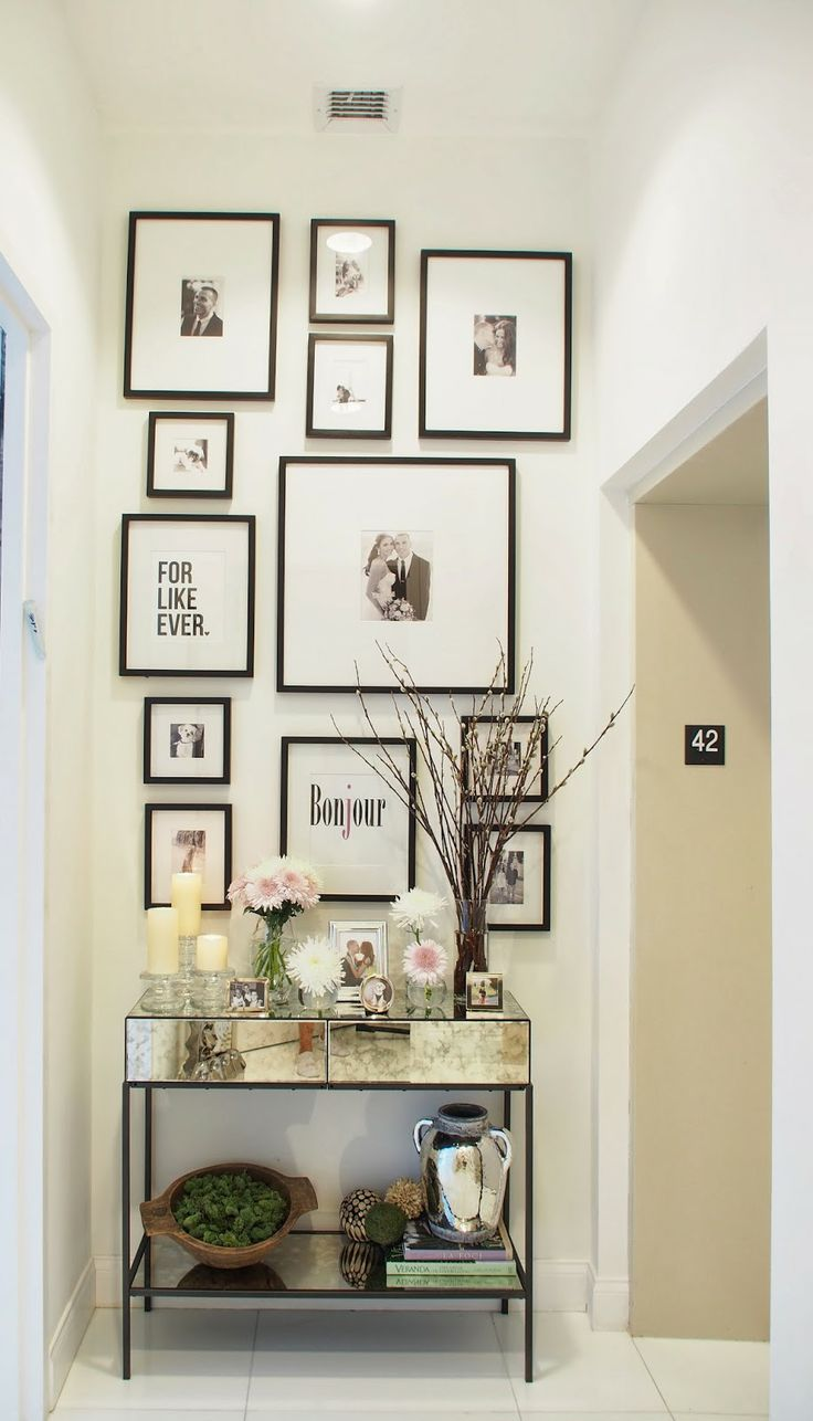 Spring Entryway Decor/Gallery Wall (Wouldn't it be nice if these were changeable frames, so you could switch out a few photos or art prints to greet the season?)