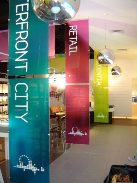 Suspended acrylic panels with clear self adhesive graphics on rear and white acrylic on face.  Luxe result!