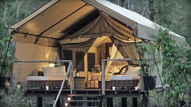 this is my kind of camping! http://www.paperbarkcamp.com.au/paperbark_deluxe_tents.html