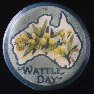 Circular badge with a blue border and background and the words 'Wattle Day' written underneath the outline of a map of Australia. Yellow wattle blossoms appear inside the map. #goldenwattle