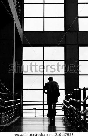 a man walking on the hallway