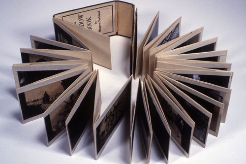 The Shadow Book by Margaret Suchland • 2 x 3.25 x 60 (extended) Altered Found Object, Mixed Media. Vintage 1930′s European accordion holder originally used to hold photographic negatives.