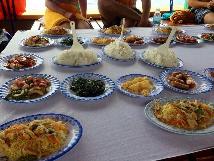 All you can eat. Nha trang snorkeling day tour. Delicious.  Noodle dish. Tuna. Springrolls.  Veggies. Calamari.  Vietnam