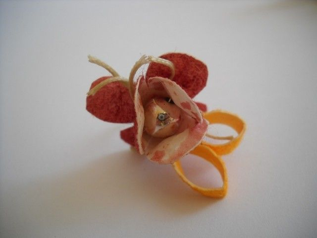 handmade ring with silk cocoons.