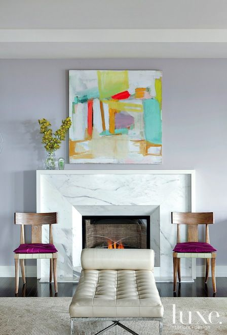 Philly shout out! This lovely apartment overlooks Rittenhouse Square. Love the fireplace surround.