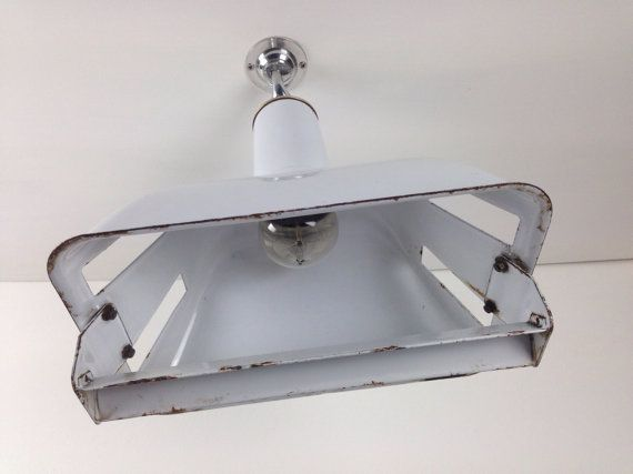 """We've been on a vintage-buying spree recently. All lights have been refurbished - polished galleries, replacement fittings if required, and cleaned up - to our exacting standards.    We currently have 12 grey and 11 white of these distinctive and very attractive original 1950s rectangular Benjamin pendants, known by the manufacturer as """"stock bins"""". The rectangular opening measures 30 x 20 cm – modestly sized – so a line of these would look amazing in a country kitchen, for instance, or a…"""