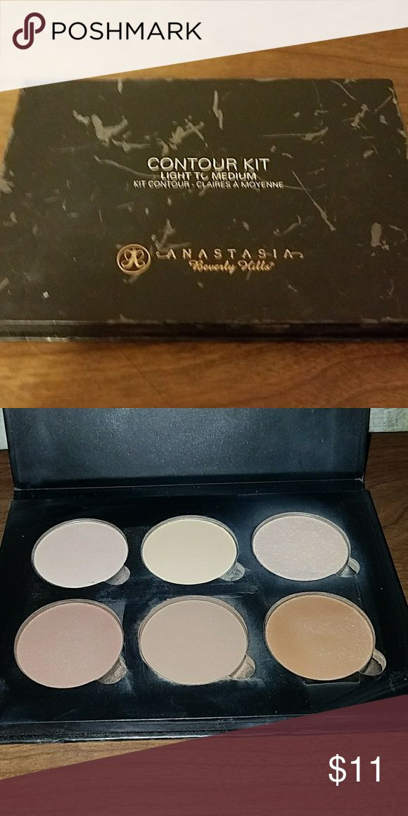 Anastasia Beverely Hills contour kit color: light to medium  This IS used, the outside is beat up, but it is in good condition with ALOT of product left. Makeup