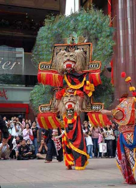 Reog Ponorogo. Heavy mask in a form of tiger's head and adorned with peacock feathers.