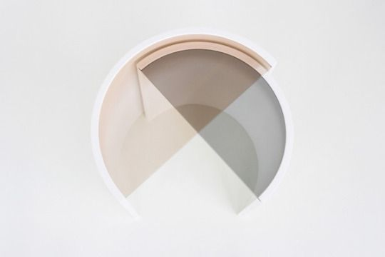 Brooklyn-based design studio Bower created a set of two minimal complimentary side tables. 'Contour Side Tables' are half-circle, tinted-glass tabletops in differing tones complete the simple, graphic look.