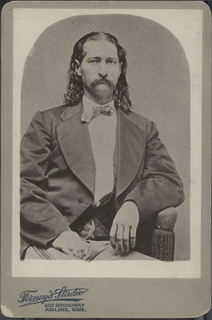 In 1876, Hickok was shot from behind and killed while playing poker in a saloon in Deadwood, Dakota Territory (now South Dakota), by an unsuccessful gambler, Jack McCall. The hand of cards which he supposedly held at the time of his death (black aces and eights) has become known as the dead man's hand.