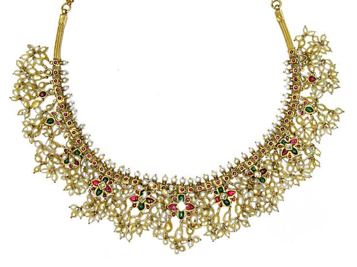 Gutta Pusalu studded with rubies, uncut diamonds, emeralds and keshi pearls, from Karni Jewellers.