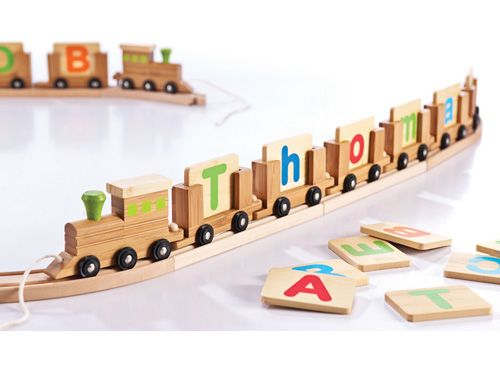 Everearth Wooden Name Train. Just choose a name and we will build your own train.  Compatible with most popular brands of train sets.